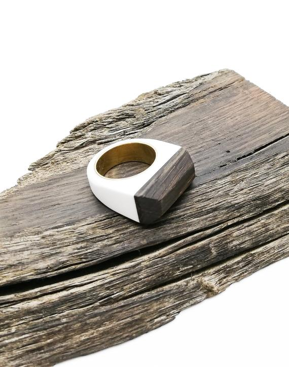 Ancient black wood, white acrylic resin and brass Ring